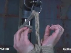 A kinky brunette tied up with fishing line and tormented