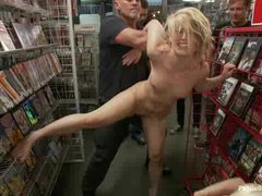 A hot blonde brutally face fucked and humiliated in a video store
