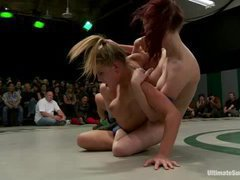 Two teams of kinky lesbians face each other in a hot wrestling match