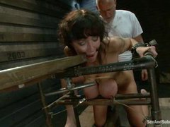 A busty MILF takes hardcore ass fucking and tit tortures