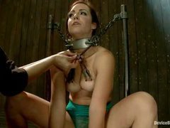 A sexy brunette cums hard with clamps on her tits