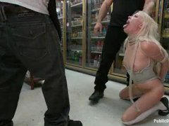 A petite blonde gets deepthroated in a convenience store