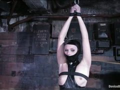 A super hot slave struggles in all custom made gear
