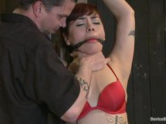 A kinky girl gets her tattooed body restrained and tormented