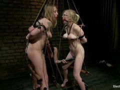 Two new busty sluts punished in an electrified predicament
