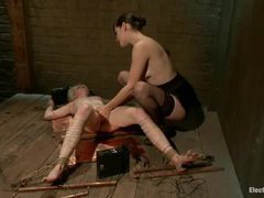 A shorthaired blonde cums on electrified copper sheets