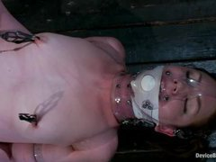 A sexy brunette takes relentless pussy torture in strict bondage