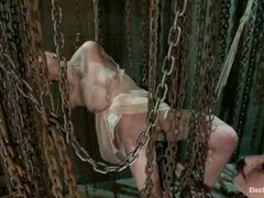 A lovely blonde balances between electrified chains