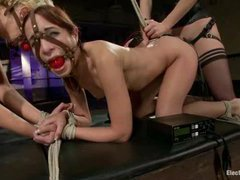 Two sexy sluts get viciously fucked by an electrified strap-on