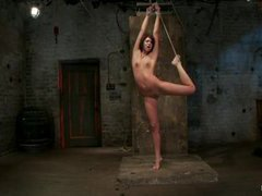 A long legged teen gets her nipples clamped in rope bondage