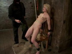 A hot cutie gets vibrated in a back breaking rope restraint