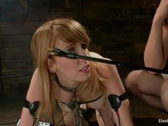 A stunning redhead licks ass while tortured with electricity