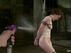 A beautiful redhead endures water torments and electro domination