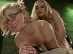 A lovely blonde in glasses gets her clit and nipples shocked