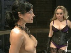 A sizzling slave girl gets tormented and fingered in a suspension