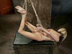 A flexible blonde cums in a category 5 hogtied suspension