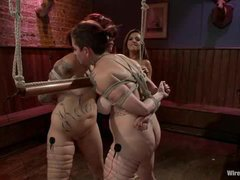 Two tattooed sluts dominated by a vicious electro mistress