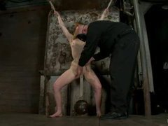 A lovely redhead receives a tight crotch rope on her swollen pussy