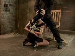 A fervent MILF gets her mouth and throat fucked in rope bondage