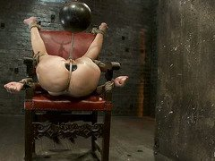 A pretty brunette takes merciless caning and rough ass fingering