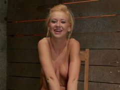 A luscious blonde dominated by Isis Love in an unforgiving strappado