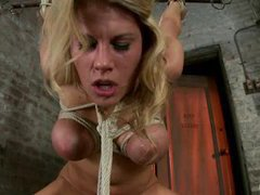 A big titted blonde gets vibrated and face fucked in bondage