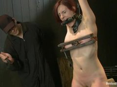 A busty redhead comes through extreme torments and earns explosive orgasms