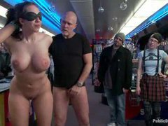 A big booty slut gets her ass fisted and fucked by kinky strangers in a porn store