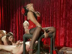 Three fabulous dominatrices having fun with a horny boy in intense CFNM action