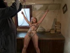 A hot blonde rewarded with body shaking orgasms after suffering from flogging and clothespins