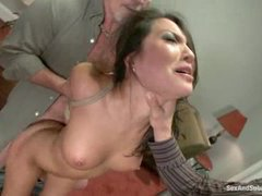 This horny busty asian gets tied up and pounded by two fat dicks