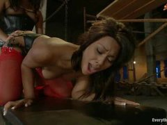 A round ass of an asian girl spanked then pounded by a fat dick and a strapon of another asian girl