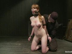 a cute teen looking girl is severely restrained and fucked with a fucking machine