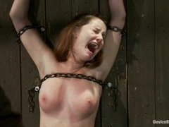 a cute busty teen redhead made to cum in bondage