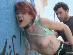 A redhead cutie walks on the streets with cum on her face