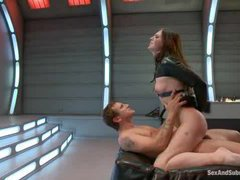 An ultimately sexy babe bound and fucked in a sci-fi room