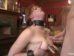 A redheaded slave girl punished and fucked by two masters
