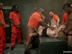 A busty blonde got her holes rammed by seven prisoners
