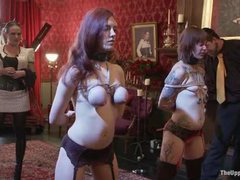 Two fiery slave girls got their tits bound and butts caned hard