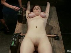 A busty redhead tormented with electricity and extreme orgasms