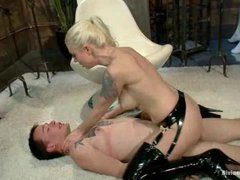 A male slave gets his cock tortured and stroked by hot mistress