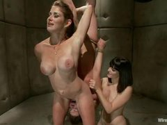 A tough pain slut pushed to her limits by two hot dommes