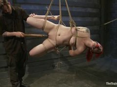 A redheaded trainee takes diabolical tortures in the dungeon
