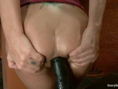 A busty anal whore gets her ass stuffed with huge toys and fisted