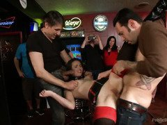 Slutty brunette is punished at a local bar with loads of spectators watching