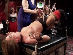 Redhead and brunette slaves get their pussies pounded roughly during wild group sex
