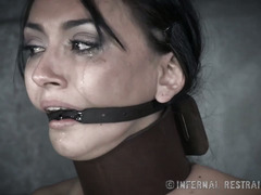 Dark-haired beauty experiences painful bondage punishment for the first time