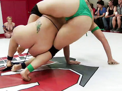 Rough and explicit interracial wrestling match between two hot babe groups