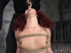 Sexy redhead ebony is screaming loudly from master's merciless punishment