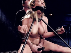 Busty blonde is screaming loudly from master's persistent pain pleasure giving